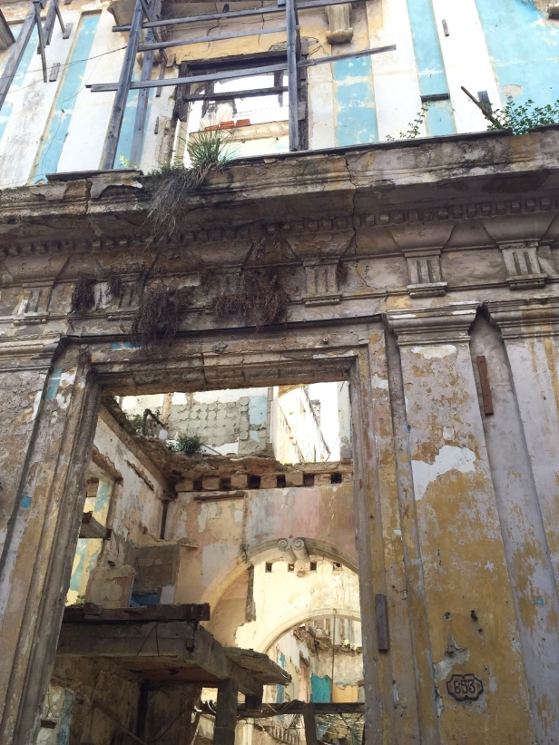 A view inside the ruins of a once beautiful mansion