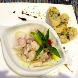 An appetizer of lemony red snapper served cold. This was as appetizing as it looks.